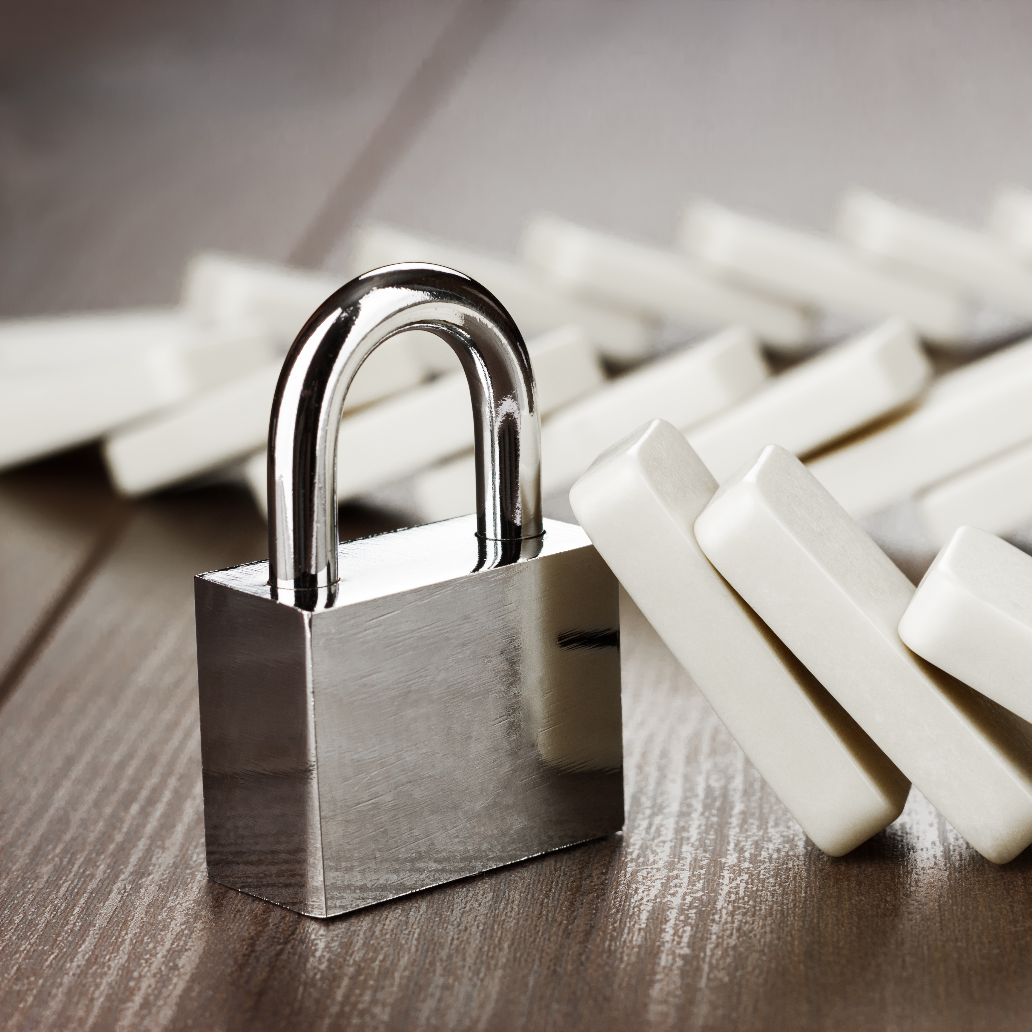 padlock standing still reliability concept on wooden table